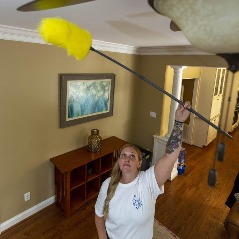 Dust and Mop cleaning technician Patricia Buckelew